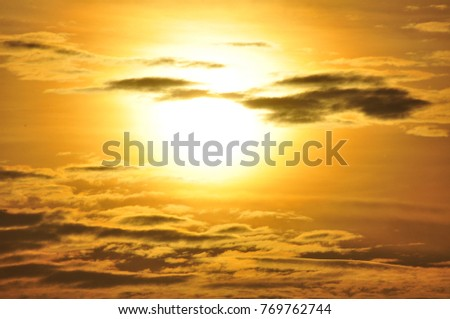 The sun is rising in the morning. With the sky and yellow gold cloud.background of the rising sun.Beautiful sunset at the mountains. Colorful landscape with sun and orange sky.