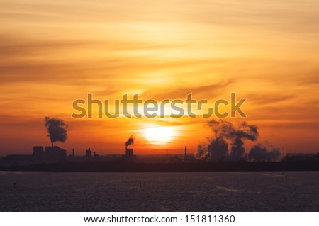 The Sun is rising over industrial Tampa (Florida).