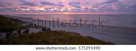 The sun is setting of the coast of the Frisian Island of Vlieland.  - stock photo
