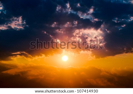 The sun lights and clouds