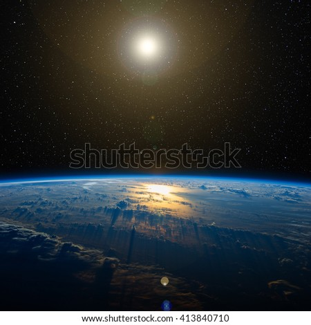 The Sun over planet Earth. Elements of this image furnished by NASA.  - stock photo