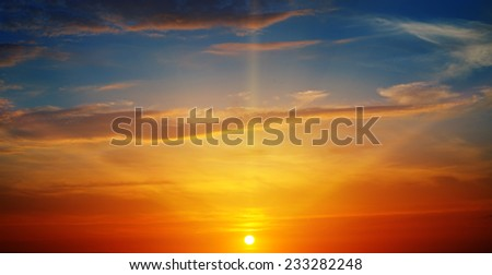 the sun rays illuminate the sky above the horizon