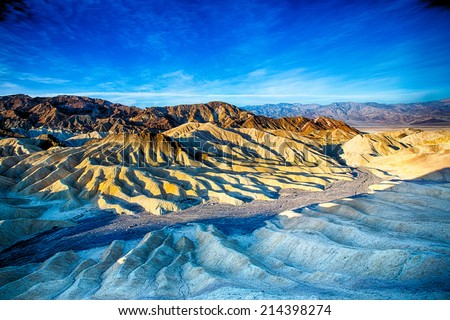 The sun rises over Zabriskie Point in Death Valley National Park, California, USA - stock photo