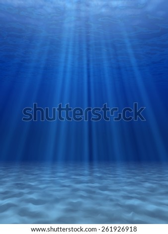 The sun's rays in the blue sea underwater. - stock photo