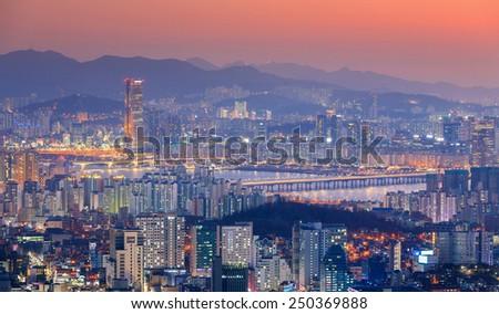 The sun set and the skyscrapers of Seoul, South Korea. - stock photo