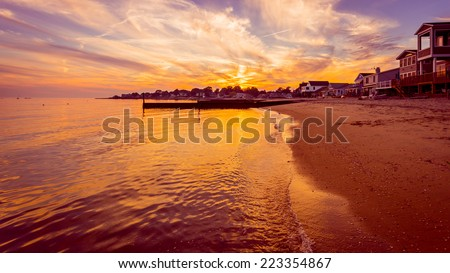 The sun sets on the final days of summer over a beach on Long Island Sound in Connecticut.