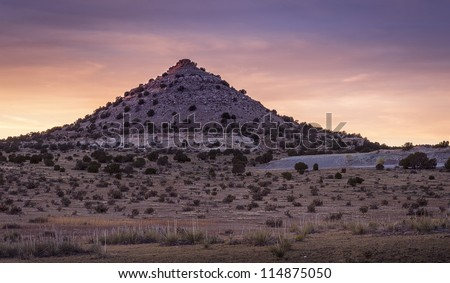 The sun sets on this pointy mountain/hill near Black Mesa in the Oklahoma panhandle.