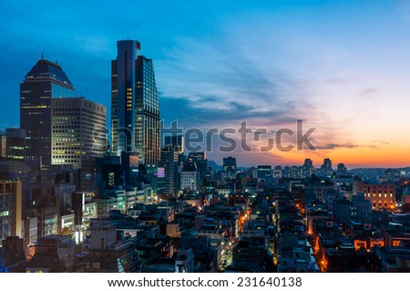 The sun sets over the Gangnam district of Seoul, South Korea. - stock photo