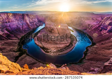 The sun sets over the iconic Horseshoe Bend in Arizona.