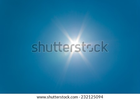 The sun shines bright in the daytime in summer. - stock photo
