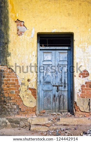 The Sun shines on a blue door in Ooty, India