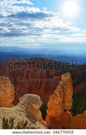 The sun shining on hoodoos at Bryce Canyon National Park. - stock photo
