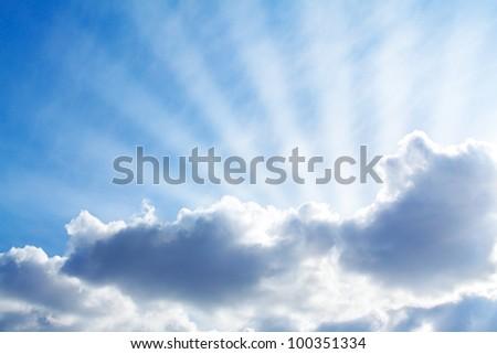 The sunbeams lighting through clouds. - stock photo