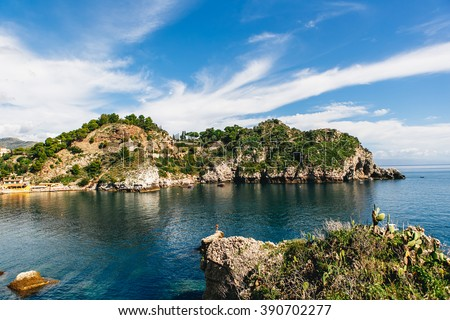 the sunny city with beautiful view on mountain, blue sky, trees, plants and sea landscape, Sicily, Italy.