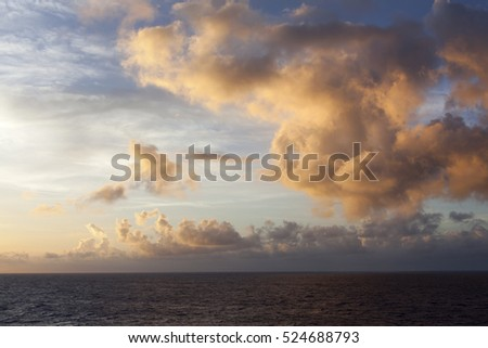The sunrise painted cloudscape over Pacific Ocean.