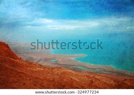 The sunrise view on the shoreline of Dead Sea under heavy clouds - stock photo