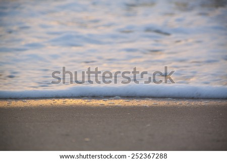 The sunrise with ocean wave - stock photo