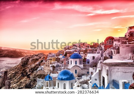 The sunset at Oia village in Santorini island in Greece - stock photo