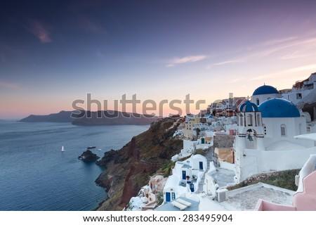The sunset at Oia village in Santorini island in Greece - stock photo