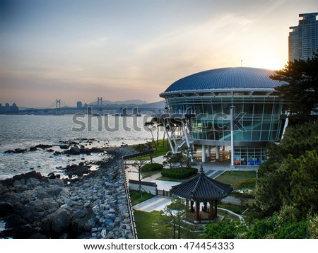 The sunset beyond the Nurimaru APEC House building in Busan