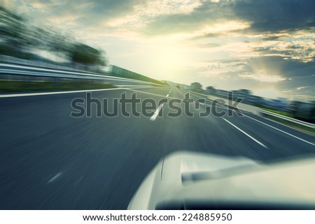 The sunset highway pavement - stock photo