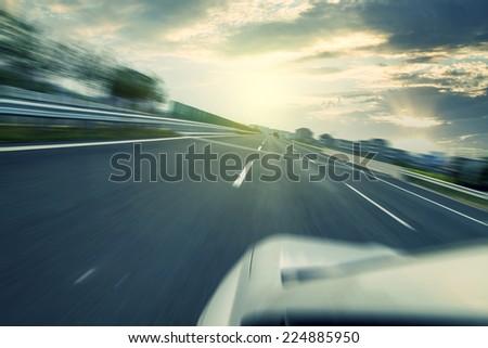 The sunset highway pavement - stock photo