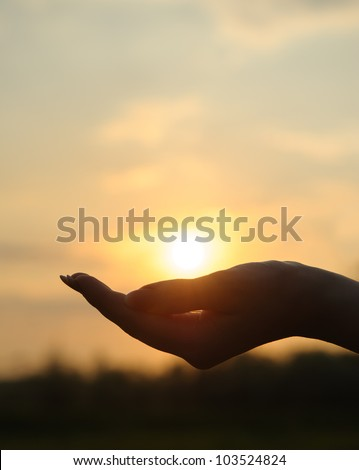 The sunset in hand. Abstract photography in backlit - stock photo