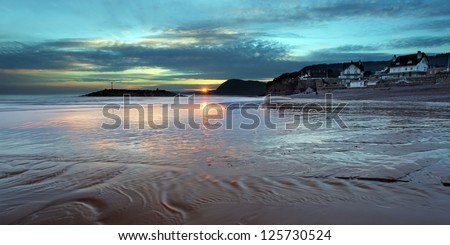 The sunsets over sidmouth beach in east devon south west england - stock photo