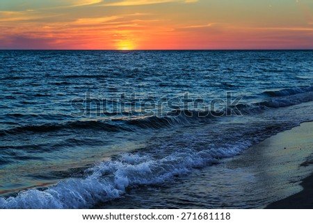 The sunsets over the Gulf of Mexico at Sanibel Island, Florida. - stock photo