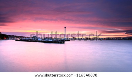 The sunsets over Weymouth seafront taken from view over the sea - stock photo