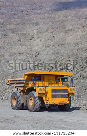 The supersize car in open pit mine - stock photo