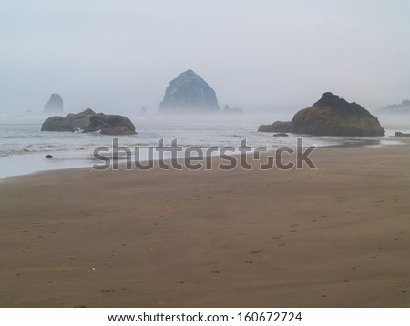 The Surf Rolling in on a Rocky Beach on the Oregon Coast USA - stock photo