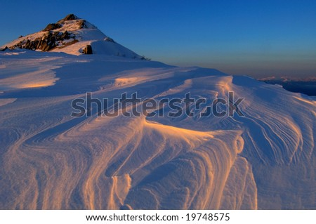 The surface of the snow of the setting sun - stock photo