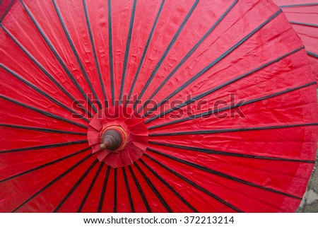 The surface of the umbrella Made of bamboo paper red.