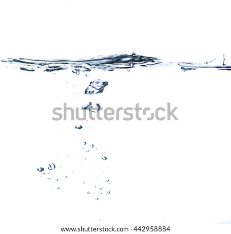 The surface of water with underwater bubbles. There is a ripple on water surface