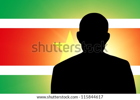 The Surinam flag and the silhouette of an unknown man
