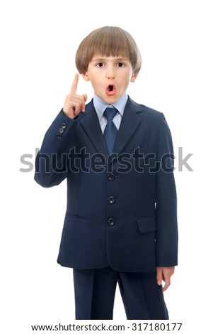 The surprised kid is pointing up with a finger