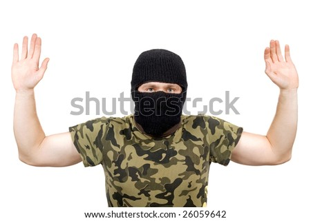 The surrendered criminal in a black mask over white - stock photo
