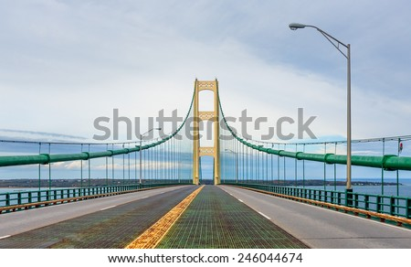 The suspension bridge over The Straits of Mackinac joins Michigan's Upper and Lower Peninsulas. - stock photo