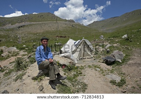 The Suusamyr valley in Kyrgyzstan. 07.20.2007. Man at a tent on a mountain pasture Suusamyr.