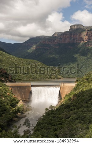 the swadini dam near the blyde river with the dragensberg as background - stock photo