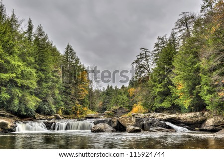 The Swallow Falls waterfall during Autumn in the western Maryland Appalachian mountains - stock photo