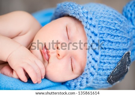 The sweet dream of newborn in blue hat - stock photo