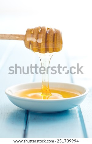 the sweet honey on dipper - stock photo