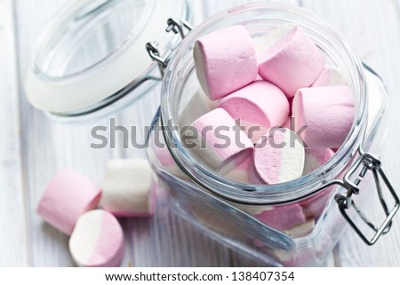 the sweet marshmallows in glass jar - stock photo