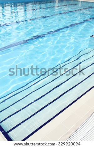 The swimming pool is outdoors. Pure blue water. - stock photo
