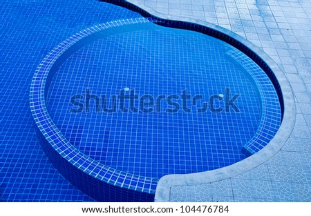 The Swimming pool with mixed blue tile mosaic - stock photo
