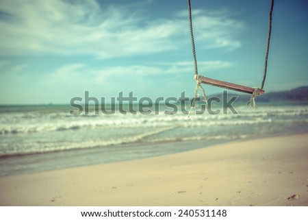 The swing against the sea waves - stock photo