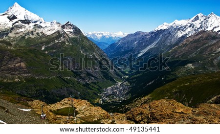 The Swiss resort Zermatt on a sunny summer day with clear blue sky - stock photo