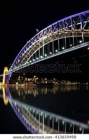 The Sydney Harbour Bridge and the city at night during Vivid Annual Festival of light - stock photo